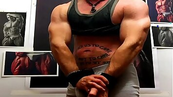 DECLAN STONE flexing and jacking at the Wall of Muscle